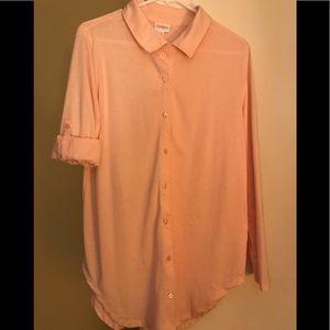 LulaRoe Valentina top. Soft peach color.